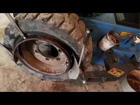 Как разобрать колесо от погрузчика