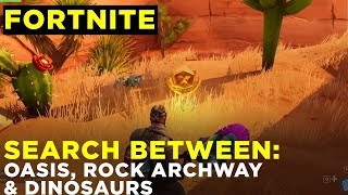 SEARCH BETWEEN AN OASIS, ROCK ARCHWAY, AND DINOSAURS