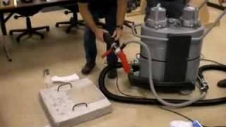Drilling through asbestos containing building material