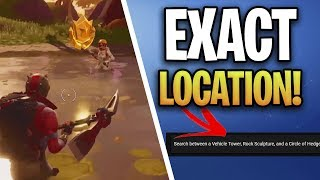Fortnite: Search Between a Vehicle Tower, Rock Sculpture, and a Circle of Hedges Location