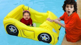 Sami and amira play with inflatable cars