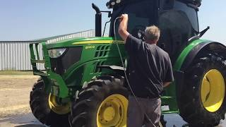 Using the John Deere 6120R for Making Hay