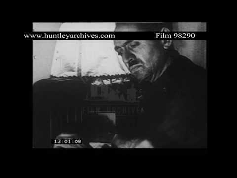 French man and French woman listen to wireless 1940's.  Archive film 98290