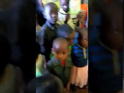 Children Receiving Bible Study Materials WFF Mois Bridge Kenya