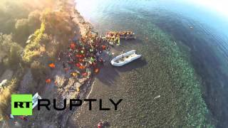 Greece: Drone footage shows refugees being helped ashore by Lesbos volunteers