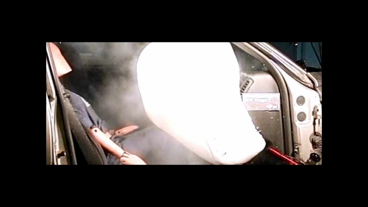 Child on passenger seat with airbag - YouTube