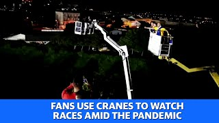Polish fans use cranes to watch races amid the pandemic