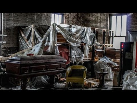 """I went ALL ALONE to an ABANDONED FUNERAL HOME (FOUND A BODY) """"Over 50 CASKETS & COFFINS Left BEHIND"""""""