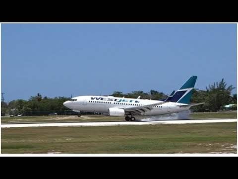 WestJet Boeing 737-700 C-GWSN Arriving in Grand Cayman