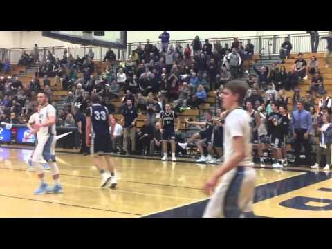 Wilsonville's Zach Reichle with the fastbreak dunk