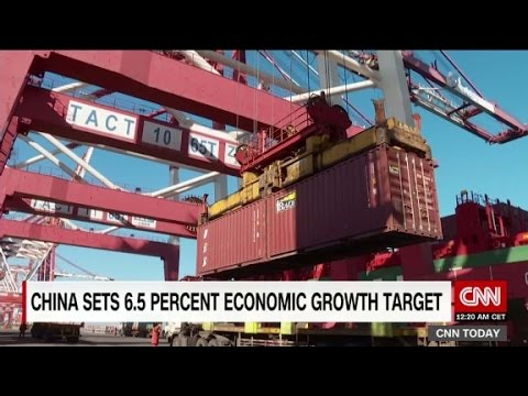 China lowers economic growth target