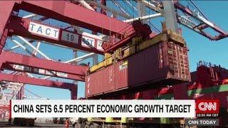China lowers economic growth target