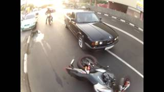 Biker get knocked off by BMW
