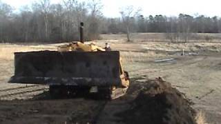 Caterpillar D9 on topsoil pile 1