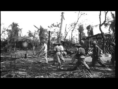 General MacArthur inspects Balikpapan, Borneo during World War II and boards a cr...HD Stock Footage