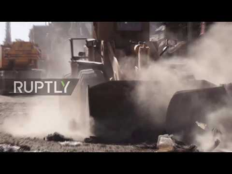 Syria: US-backed militias clear and comb rubble-strewn Raqqa streets *GRAPHIC*