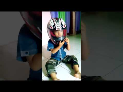 a child wearing a full face helmet tribulation great very funny