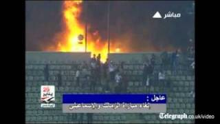 Cairo stadium up in flames on night of football violence in Egypt