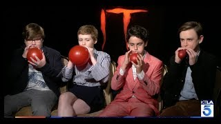 """The Stars of the film """"IT"""" race to blow up the iconic Red Balloon"""