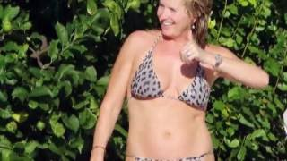 Hot legs! Penny Lancaster shows off her fantastic figure in a tiny two piece