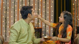 Happy siblings sharing sweets on the occasion of Raksha Bandhan / Bhai Dooj
