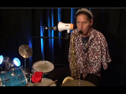 Neill Duncan plays the one-handed saxophone and drums