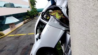 Firefighters rescue woman from dangling car in Miami Springs