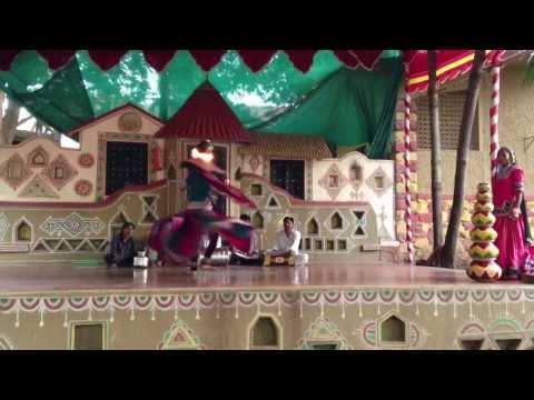 Creative way to heat up water!  Rajistani folk dancing Chokhi Dhani Pune