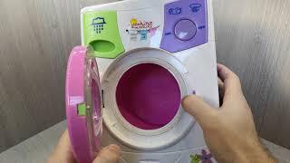 Дитяча пральна машина - стирає речі з водою!