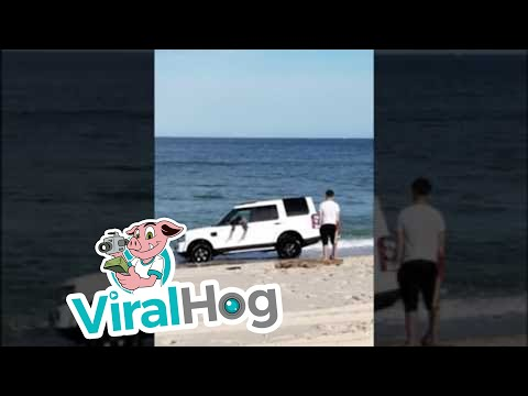 Land Rover Swamped on the Beach