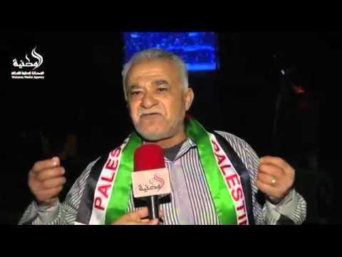 متابعة الجماهير الفلسطينية بغزة مباراة الجزائر والمنØ