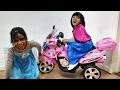 Little Girls Decorate PINK BMW Motorbike Ride On with Frozen Elsa & Anna Stickers