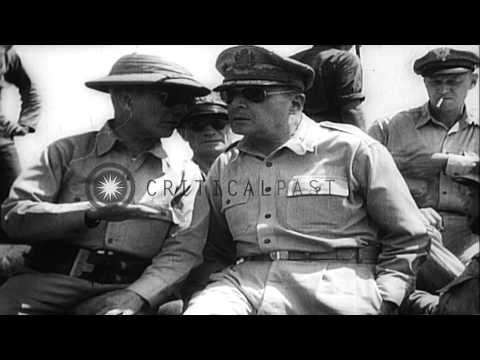 General MacArthur returns to the Philippines; seen wading ashore. HD Stock Footage