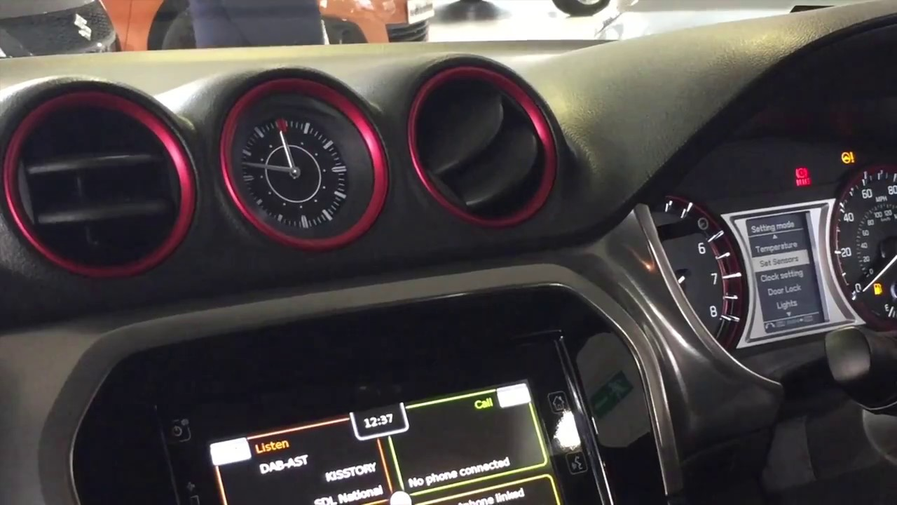 How to change the clock in a Suzuki Vitara