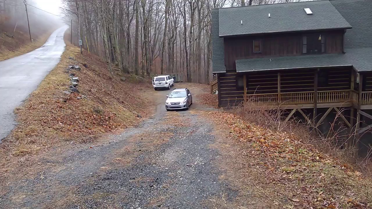 Driving subaru impreza up a steep and slippery driveway for Steep driveway construction