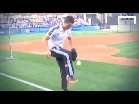 Cristiano Ronaldo juggles with a baseball