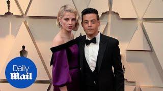 Love Doves! Rami Malek and Lucy Boynton embrace at 2019 Oscars