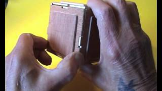 A puzzle box where most of the working parts are on the outside. Unlike normal puzzle boxes, you can see what