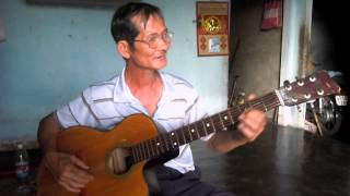 Nghệ nhân hát then nhạc đệm bằng đàn ghi ta