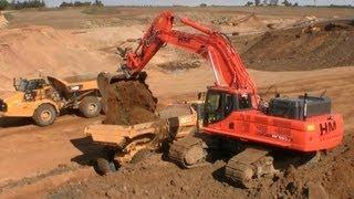 Video still for Doosan DX530-3 Excavator Loading Cat And Bell Dumpers