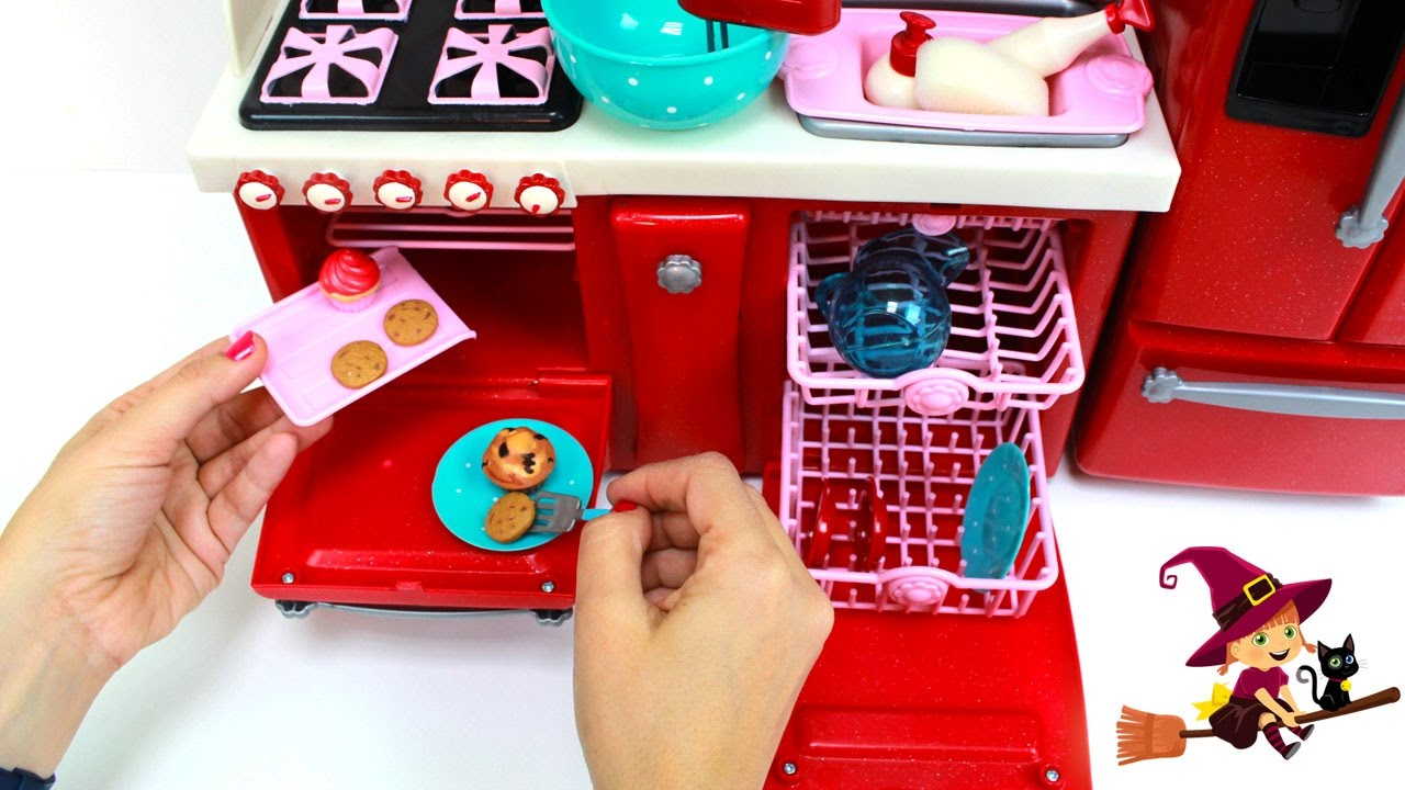 Cocinita de juguetes con much simos accesorios de cocina for Juguetes de cocina