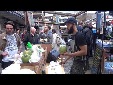 A Coconut Master shows one of the Worlds Fastest Ways to Open a Coconut (3 to 4 secs) Camden Market.