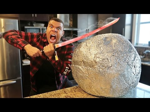 Thumbnail: EXPERIMENT Glowing 1000 degree KATANA VS GIANT METAL BALL!