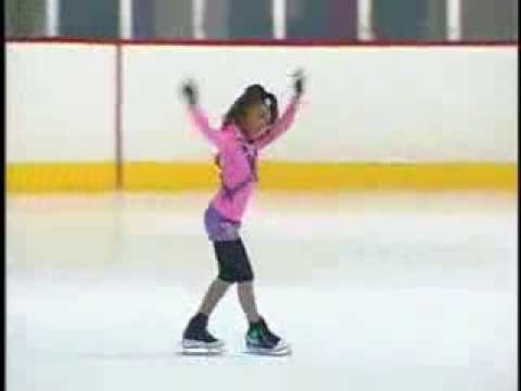 Little Skater Whips Her Hair Back And Forth