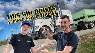 Kid drives a BRAND NEW Peterbilt Truck!