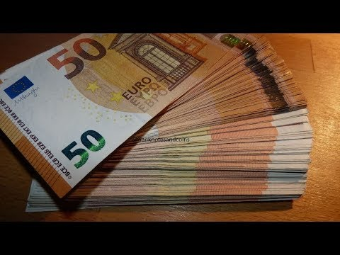 Counting stack of 50 EURO banknotes new and old CASH