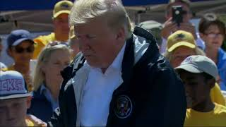 Trump handing out warm meals to Florence victims thumbnail