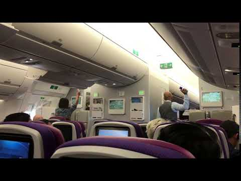 Aircraft cabin being sprayed prior to landing at London Heathrow LHR