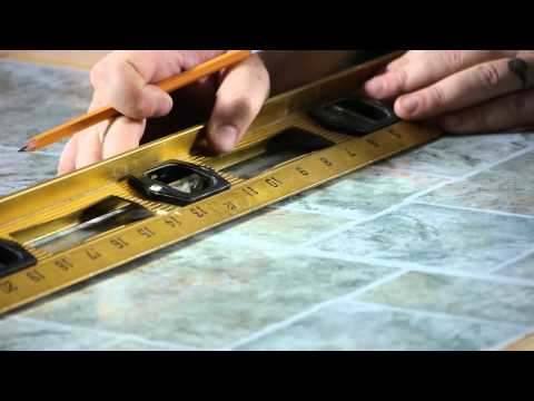 how-to-install-self-adhesive-floor-tiles-on-top-of-old-tiles-:-working-on-flooring