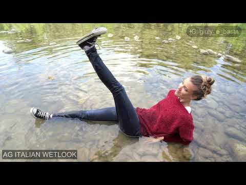 Wetlook - Giulia fully clothed at the river with black old converse - Preview